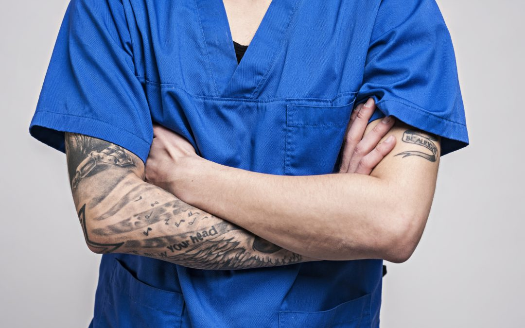 Is it unprofessional for doctors to have tattoos or facial piercings?