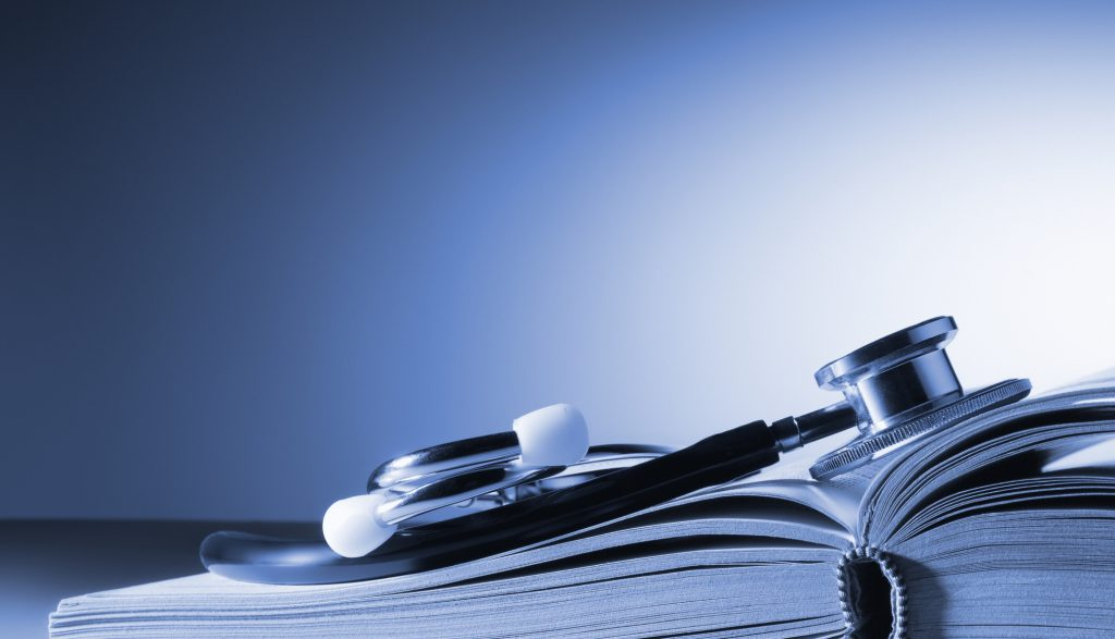 Close-up of a doctor's stethoscope on an open medical book