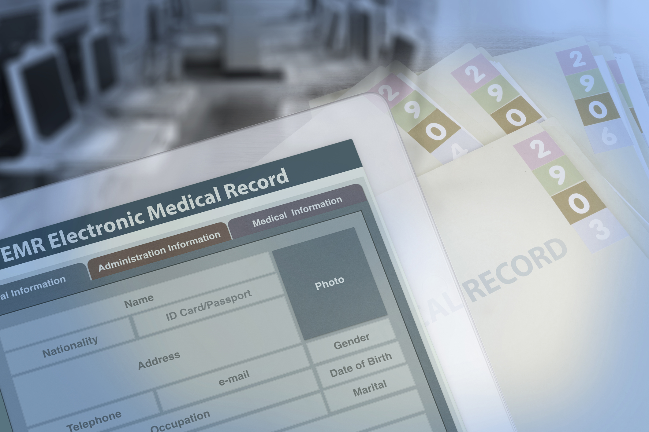Concept photo of electronic medical records on top of paper records