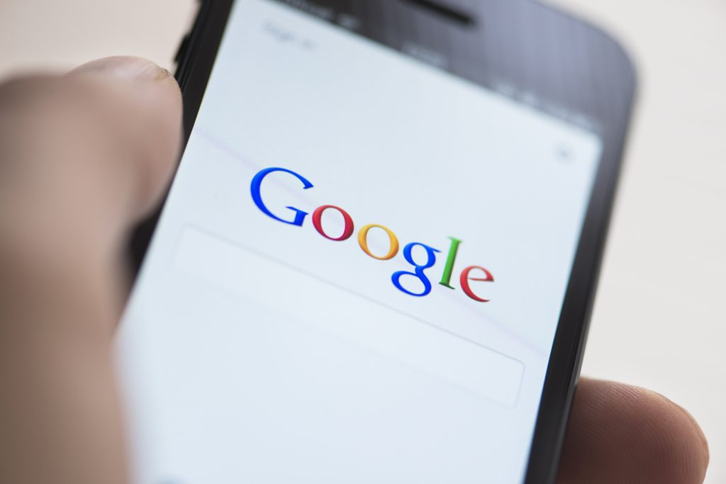 Closeup of smartphone screen with Google on the screen