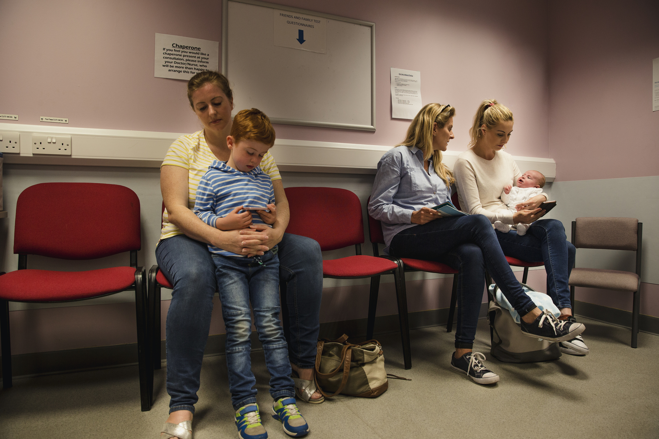 Two families waiting in a hospital waiting room