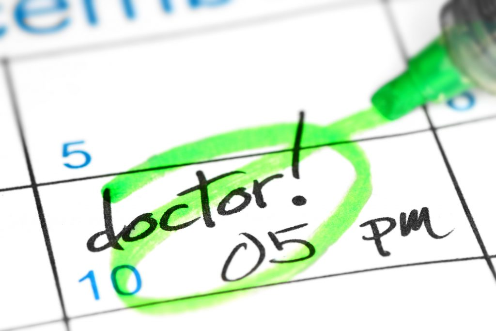 Close up of calendar with a doctor's appointment circled