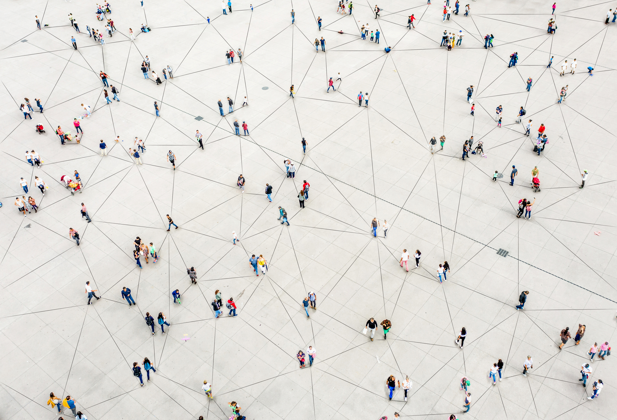 Birds eye view of a sparse crowd of people connected together by lines