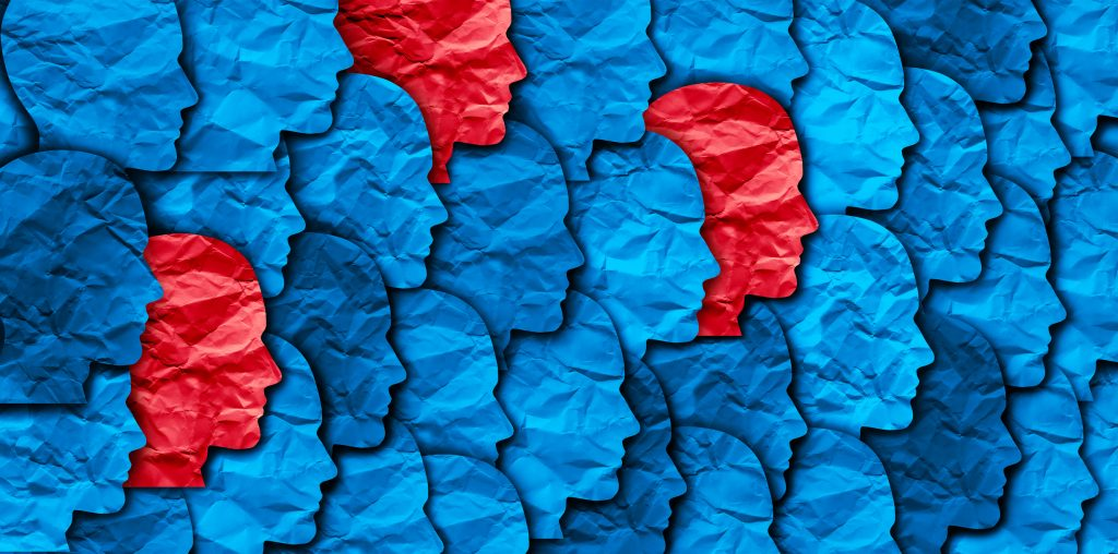 Concept illustration of layered red and blue paper cutouts of a head in profile