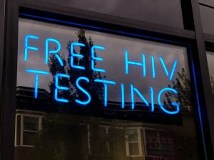 """A neon window sign stating: """"Free HIV testing"""""""