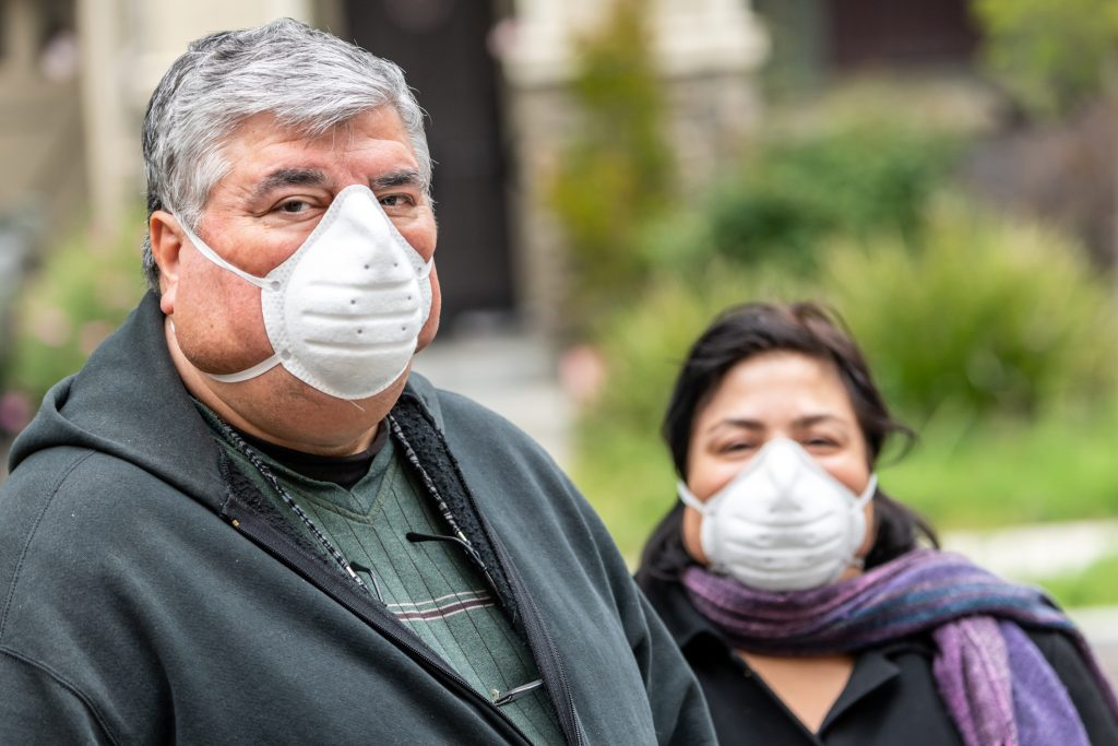 An senior couple with obesity wearing N95 masks due to COVID-19