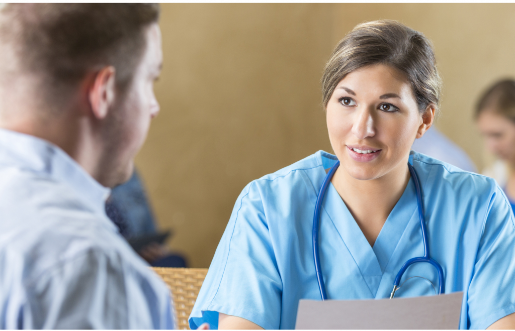 Female physician sitting for a job interview with a male recruiter